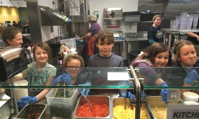 Children volunteering at soup kitchen